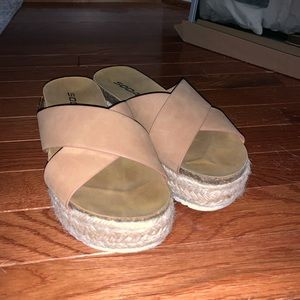 Wedged sandals with a strap